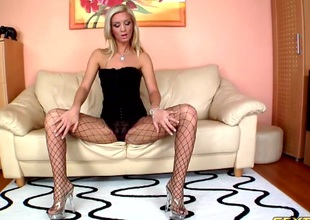 That babe keeps her heels and fishnets on during the time that fucking two guys at once