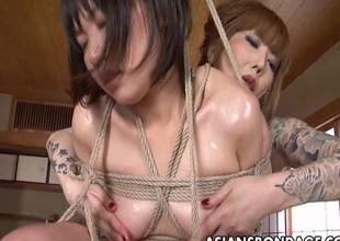 Asian servitude slut has her wet cunt fingered by a lesbian