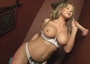 Appetizing big breasted auburn MILF Nikki Sexx gives oral stimulation in confessional