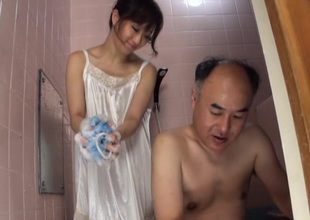 Japanese Dark brown performs nice blowjob to her spouse in shower
