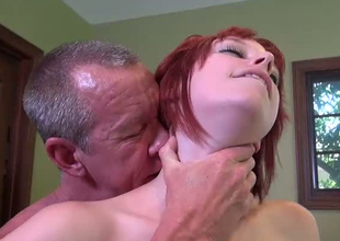 Redhead cock engulfing slut blows dick of a mature freak