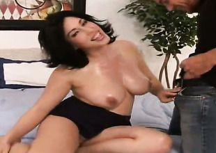 Vanessa James with round bottom and bald bush polishes Justin Magnums pulsating pole with her lips