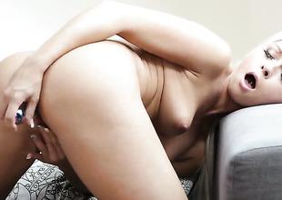 Breathtakingly sexy pornstar Naomi Nevena spreads her legs to fuck her moist wet spot with sex toy