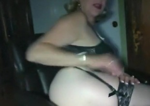 Blonde gilf rubs her wet pierced trimmed pussy and lets her chap eat her out on an office chair