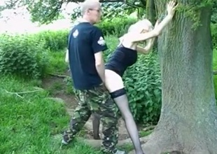 Gilf in sex lingerie gets doggystyle fucked in the garden during daytime