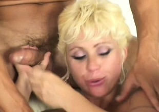 Slutty fishnet MILF pleases two large cocks in a steamy threesome
