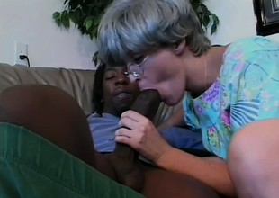 Breasty mature woman can't get sufficiently of a black prick drilling her cunt