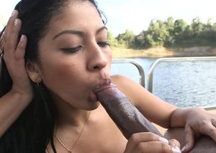 Two Colombian angels are engulfing off a guy in a threesome on a boat