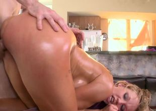 A blonde with a big booty is and large breasts is fucking her masseur