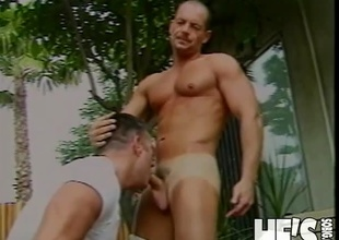 Doug Jeffries loves sucking dick! In this scene he's intend to engulf on Sam Crockett's hard cock before getting his ass drilled from behind! Doggie style it is as Sam ploughs away before inevitably shooting a load on to Doug's face!