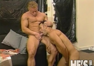 Two muscle studs take turns blowing on each others hard cocks in advance of they both blow their loads all over each others hot hard bodies!