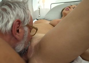 A busty blonde is getting some old dude's cum on her milk shakes