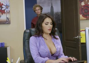 Breasty bimbo is in the office and she is getting her legs on a dick