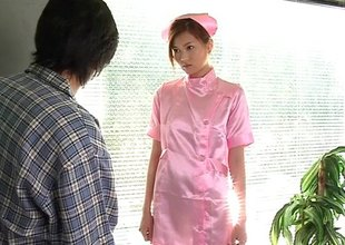 Legal age teenager Japanese nurse has her hairy cunt lubed up and fucked