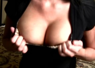 Amateur brunette shows her large boobs for the camera