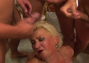 Big mama getting loads of cocks to swallow