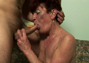 Dissolute granny Angela Reed gives really good oral sex to a sexy guy