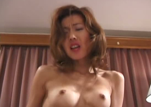 Desirable Japanese skank is drilled in a missionary position