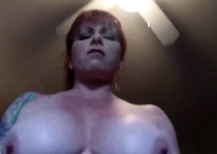 Tattooed redhead MILF riding - POV