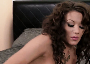 Dark brown Becky Holt with hairless twat has fire in her eyes as that babe masturbates