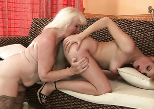 Blonde Laraan with gigantic jugs has some time to give some sexual pleasure to lesbo Mylen