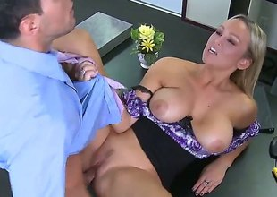 Blond Abbey Brooks with huge breasts gets a good hard fucking in porn action with Mikey Butders