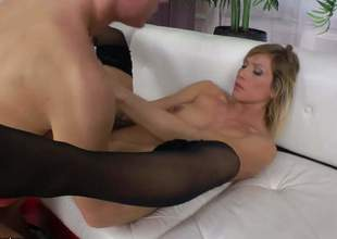 Horny whore Rita Rush in black nylon stockings displays her valuable juicy natural boobs as horny dude drills her asshole. Shaved pussy slut gets slammed in the ass on the couch and loves it