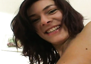 Dark brown chick is completely naked and plays with her honeypot non-stop