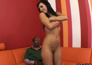 Cleanly shaved dark-haired chick is having nice sex on red couch