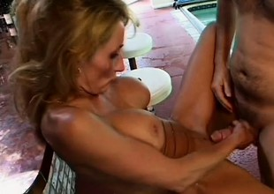 Naughty milf with big mounds has the pool boy taking care of her desires