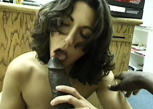 Luscious brunette hair drops to her knees and worships a huge black stick