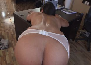 A huge butt chick is getting rammed in the office by her boss