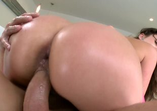 A kinky bitch with a big ass is opening up her wet pussy and her butt