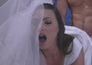 A sexy blond in a wedding dress is getting permeated by a dude