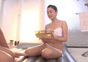 Fabulous Asian masseuse oils up a man and sucks his dick