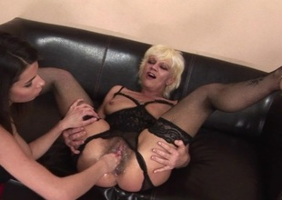 Kinky older slut getting fisted by a hawt babe