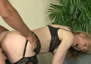 Dissolute golden-haired hoe with skills Nina Hartley fucks a hunk