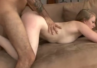 Pale skinned whore is screwed hard in a doggy position