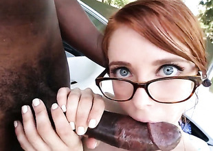 Redhead is giving a blow job