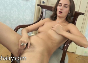 Melody gives you a good view of her unshaved vagina