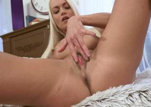 Lovely long-haired blonde Lina Love parts her legs to play with her tight pussy fro your viewing pleasure. This babe makes her finger disappaer in her love tunnel right in front of the cam