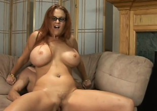 Redhead cougar with large hooters Kitty Lox is desperate to get fucked
