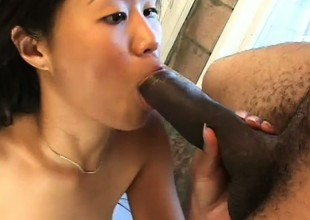 Filthy Oriental slut has a nasty addiction to stiff black cock
