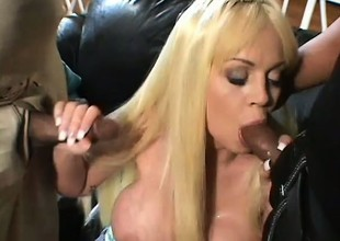 MILF gets two gigantic black dicks in the one and the other her holes at one time
