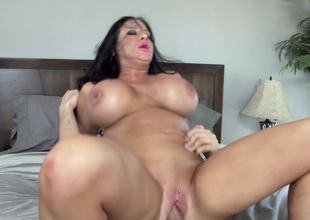 Massive fake titties on the milf playgirl riding a big dick