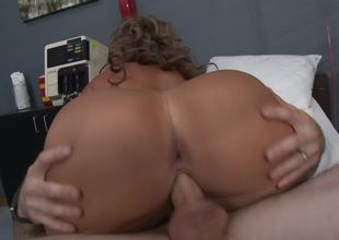 A curly blonde that likes to ride schlong is fucked by the doctor