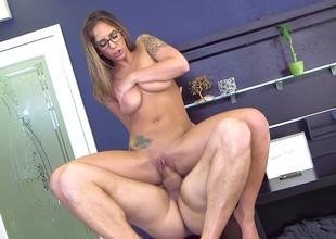 A brunette with glasses is getting a dick in her wet snatch today