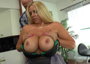 A blond with a valuable rack is getting permeated by a large dude