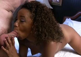 Curly-haired Ebony Michelle Brown gets a white rod