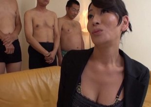 Stunning older Japanese woman in lingerie gets a facial cumshot